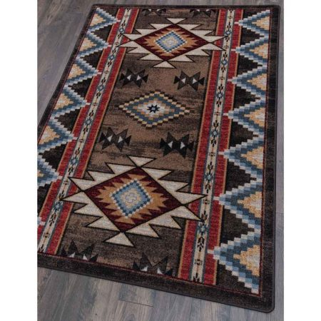 Southwestern rug with a brown background and motifs in red, blue and tan