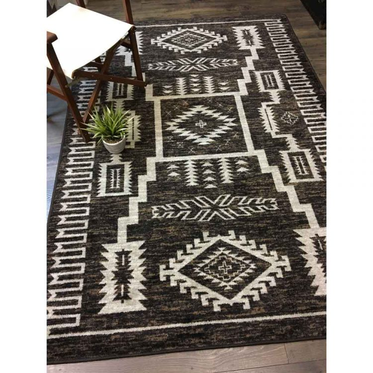 Brown area rug with Southwestern pattern in off-white