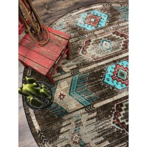 Round Southwestern rug with distressed pattern in brown and turquoise