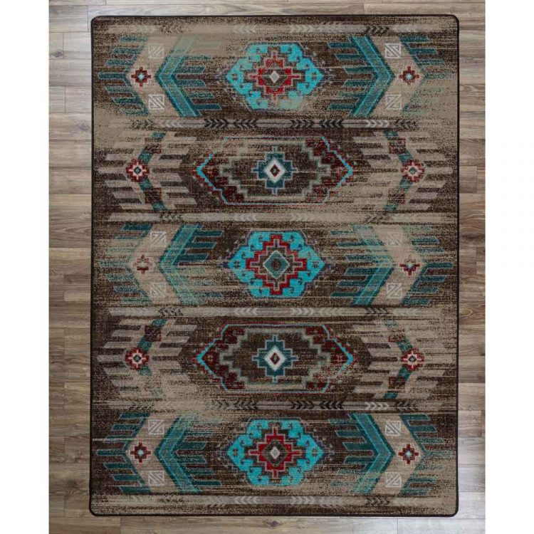 Southwestern area rug with faded and distressed pattern in chocolate brown and turquoise