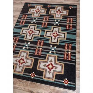 Area rug with a black and turquoise background with Southwestern crosses