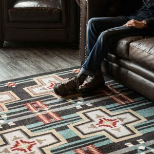 Black Southwestern rug with teal stripes and tan crosses