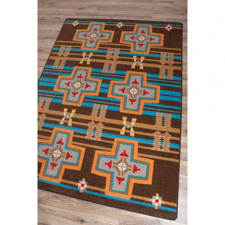 Brown area rug with turquoise stripes and Southwestern cross and prints in orange