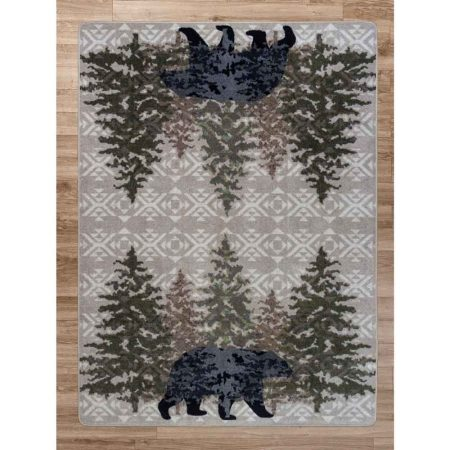Rustic area rug with a bear and pine trees print on a gray background