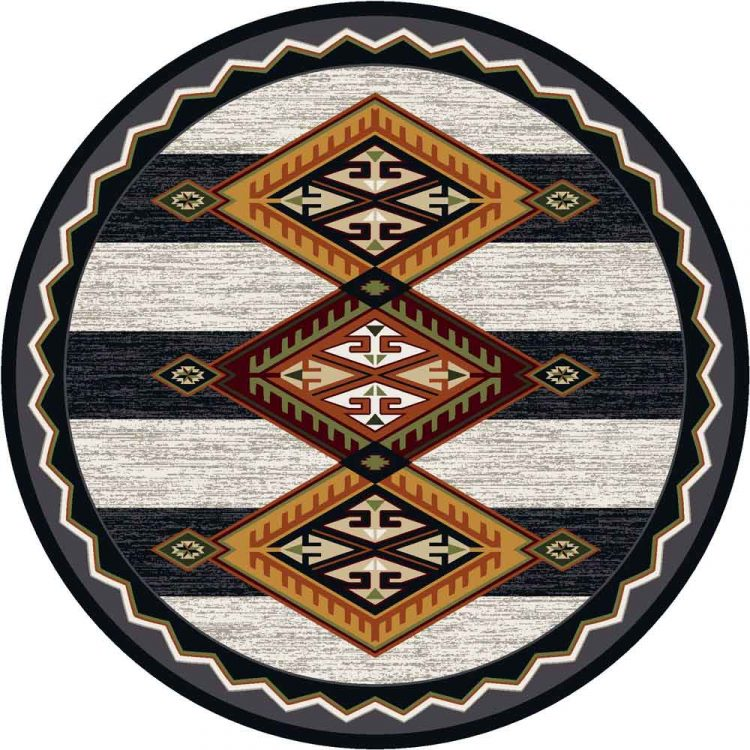 Round area rug with a black and white wide striped background and orange and red Southwestern patterns