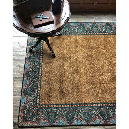 Area rug with a solid background in warm brown with a turquoise Persian inspired border