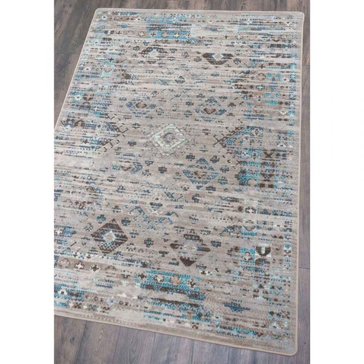 Area rug with distressed Southwestern patterns on a gray background