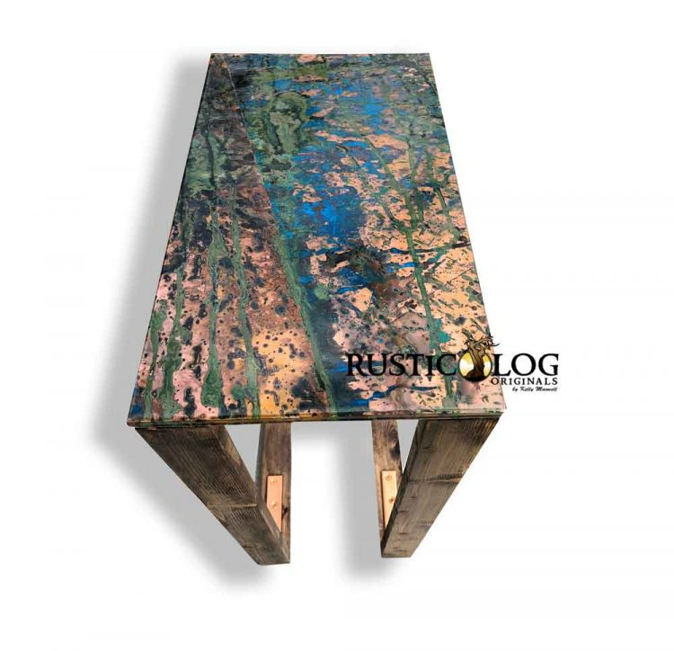 Alternate view of a copper table to show color and texture of the patina