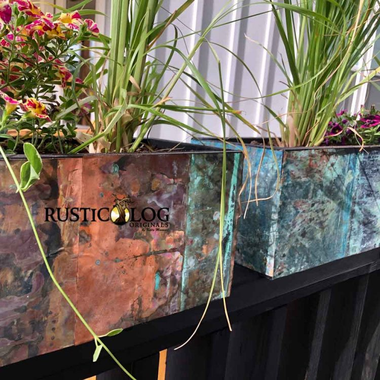 Planter boxes made with a copper outer layer with custom patina